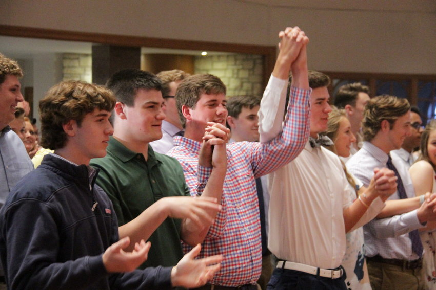 """Members of Fr. Tolton Regional High School's Class of 2019 pray the """"Our Father"""" during their Baccalaureate Mass in Our Lady of Lourdes Church in Columbia."""