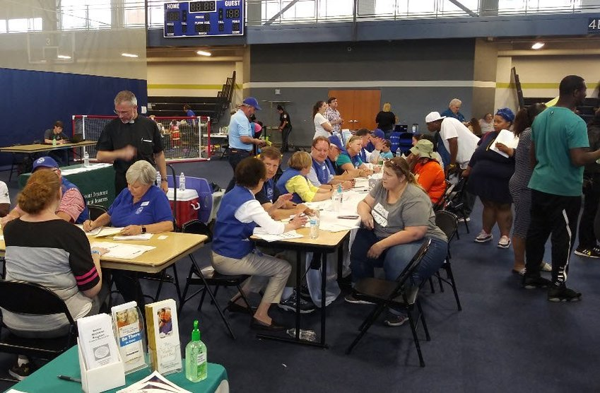 St. Louis and Central Missouri volunteers from the Society of St. Vincent de Paul assist victims of a May 22 tornado during a Multi-Agency Resource Center (MARC) event in Jefferson City.