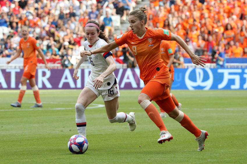 Rose Lavelle (left) of the United States, a graduate of Mount Notre Dame High School in Reading, Ohio, and Vivianne Miedema of the Netherlands battle for the ball during the FIFA Women's World Cup in Lyon, France, July 7, 2019. The U.S. won its record fourth Women's World Cup title and second in a row, beating the Netherlands 2-0.
