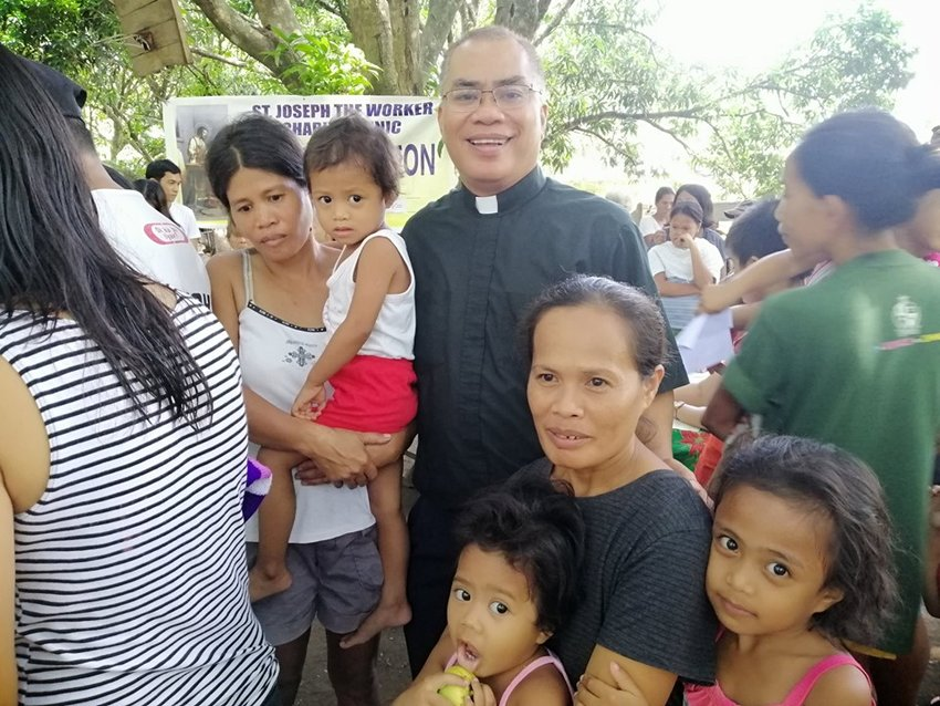 "Father Donardo ""Dandi"" Bermejo and the staff of the St. Joseph the Worker Mission to the sugarcane plantation workers in the Negros Occidental district of the Philippines offers medical care during a field mission to the neighboring Diocese of Kabankalan."