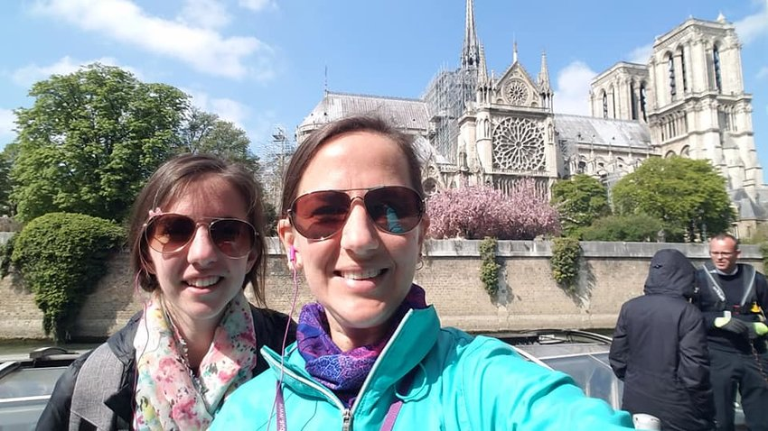 "Karen and Helen Timpe take a ""selfie"" outside Notre Dame Cathedral in Paris on Palm Sunday, a few hours before the roof was engulfed in flames."