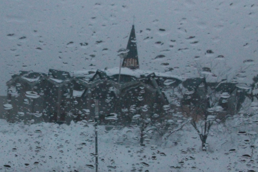 The Cathedral of St. Joseph resembles an Impressionist painting through a window in the rain.