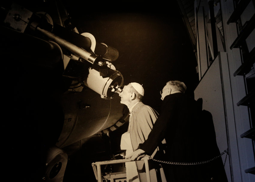 Pope Paul VI views the moon through the viewfinder of the Schmidt telescope at the time of the first landing on the moon, July 20, 1969. This print was photographed on display at the Vatican observatory in Castel Gandolfo, Italy, Sept. 28, 2018.