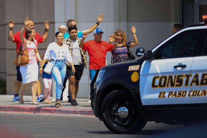 Shoppers exit with their hands up after a mass shooting at a Walmart in El Paso, Texas, Aug. 3, 2019. In Aug 3 tweets, the Catholic dioceses of El Paso, Texas and neighboring Las Cruces, New Mexico asked for prayers for everyone involved at this difficult time.