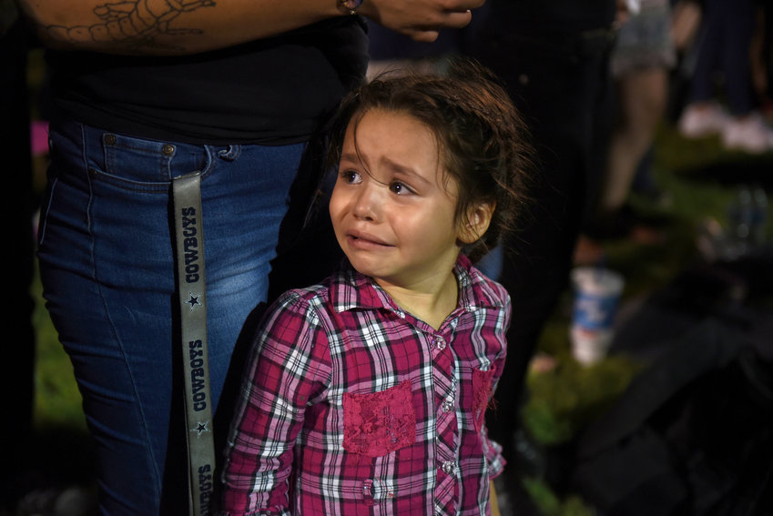 Serenity Lara cries during an Aug, 4, 2019, vigil, a day after a mass shooting at a Walmart store in El Paso, Texas. Pope Francis joined Catholic Church leaders expressing sorrow after back-to-back mass shootings in the United States left at least 31 dead and dozens injured in Texas and Ohio Aug. 3 and 4.