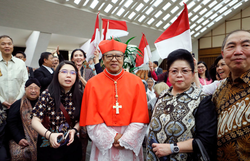 New cardinal Ignatius Suharyo Hardjoatmodjo of Indonesia meets with members of his family after a consistory for the creation of 13 new cardinals at the Vatican Oct. 5, 2019.