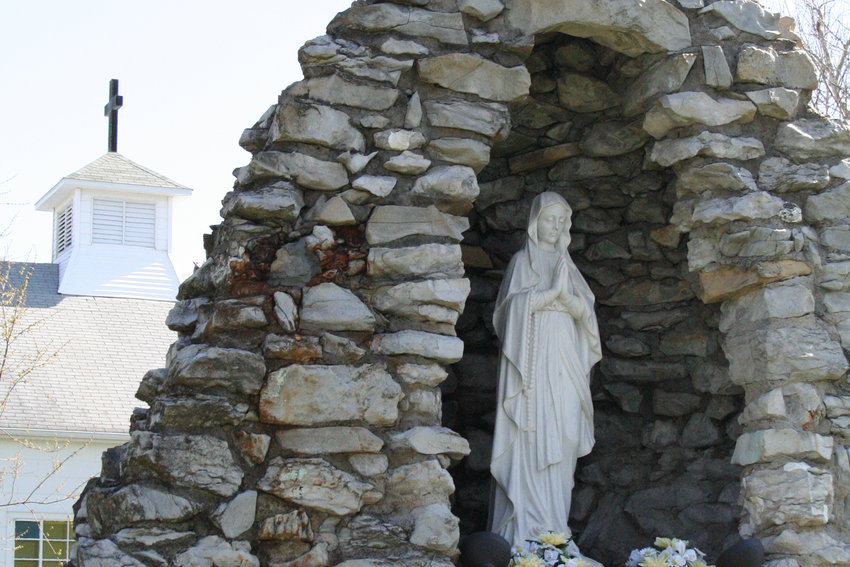 A grotto of the Blessed Mother stands outside the Church of the Resurrection in Wellsville.