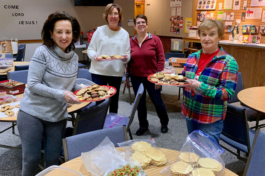 Lusica Hankins, Ann Wallace, Melodi Graessle and Peggy Henderson of Our Lady of the Lake parish in Lake Ozark prepare Christmas cookie trays to deliver to parishioners who are homebound or are residents of local nursing homes.