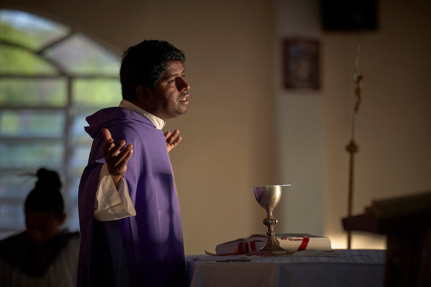"Father Edwin Anthony, a Jesuit missionary from India, celebrates Mass in St. Ignatius, Guyana, April 6, 2019. In Pope Francis' postsynodal apostolic exhortation, ""Querida Amazonia,"" released Feb. 12, 2020, the Pontiff acknowledged the serious shortage of priests in remote areas of the Amazon, but he insisted not all avenues have been exhausted to address the issue."