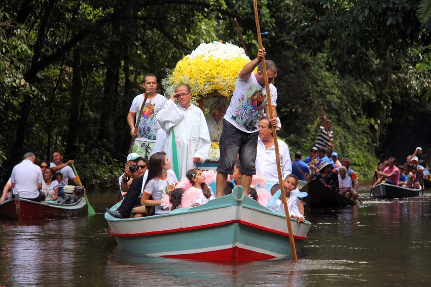 "Pilgrims travel in boats as they accompany the statue of Our Lady of Nazareth during an annual river procession and pilgrimage along the Apeu River to a chapel in Macapazinho, Brazil, Aug. 3, 2014. The Vatican released Pope Francis' postsynodal apostolic exhortation, ""Querida Amazonia"""