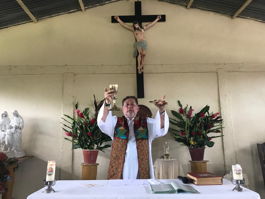 "Jesuit Father Alfredo Ferro celebrates Mass July 14, 2019, in the indigenous community of Nazaret, Colombia. In Pope Francis' postsynodal apostolic exhortation, ""Querida Amazonia,"" released Feb. 12, 2020, the pontiff acknowledged the serious shortage of priests in remote areas of the Amazon, but he insisted not all avenues have been exhausted to address the issue."
