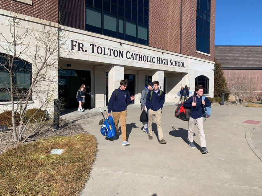 Students depart from Fr. Tolton Regional Catholic High School in Columbia at the end of the day on March 3. A group of donors who wish to remain anonymous pledged to eradicate the school's $6.2 million debt, freeing up resources to expand and enrich the educational and formation programs at the school, which opened in 2011.