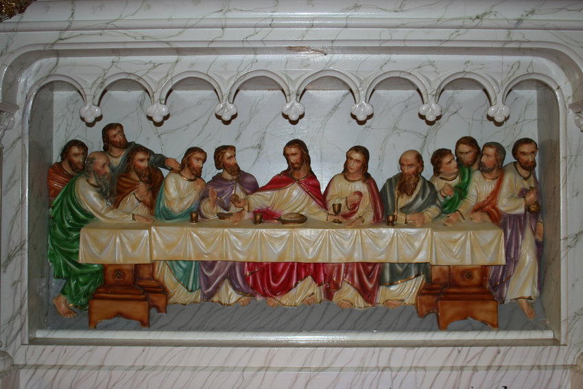 This image of the Last Supper adorns the altar in Sacred Heart Church in Bevier.