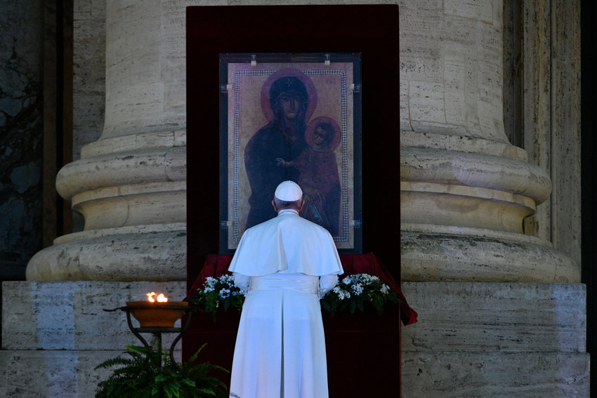 "Pope Francis prays in front of the Marian icon, ""Salus Populi Romani"" (health of the Roman people), during a prayer service in an empty St. Peter's Square at the Vatican March 27, 2020. At the conclusion of the service the pope held the Eucharist as he gave an extraordinary blessing ""urbi et orbi"" (to the city and the world). The service was livestreamed in the midst of the coronavirus pandemic."