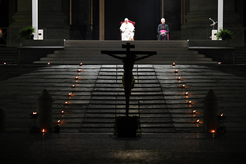 Pope Francis leads the Via Crucis procession in St. Peter's Square at the Vatican April 10, 2020. The Good Friday service was held with no public participation because of the COVID-19 pandemic.