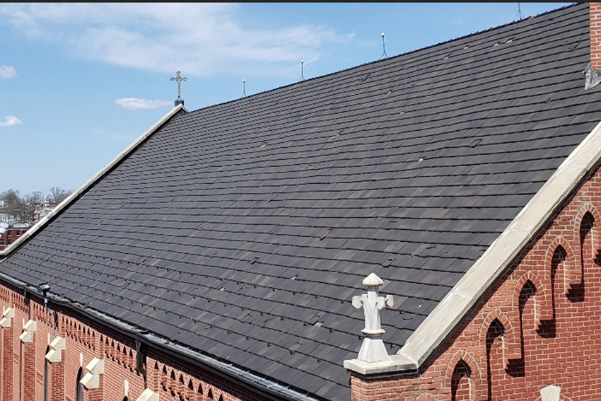 Hail damage to roofing tiles at St. Peter Church in Jefferson City is plainly visible from the roof of the rectory next door.