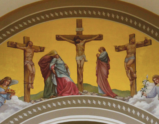 This nearly 25-foot-wide, gilded mural depicting the Crucifixion adorns the chancel arch above the altar in St. Joseph Church in Westphalia. It is part of a nearly completed, massive renovation of the church.