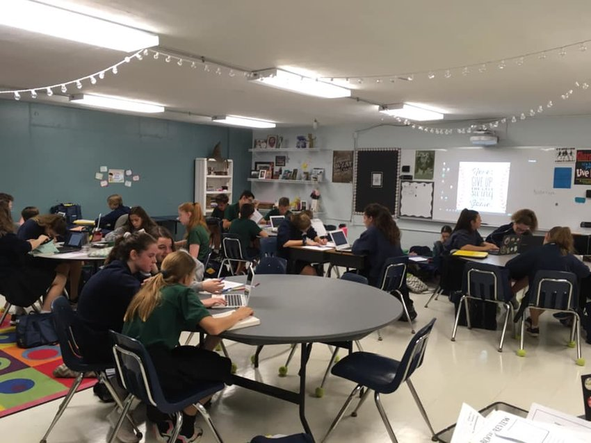 This Oct. 11, 2019, photo of the eighth-grade English class at St. Joseph School in Manchester is from the Saint Joseph Catholic Elementary School and Preschool Facebook page.