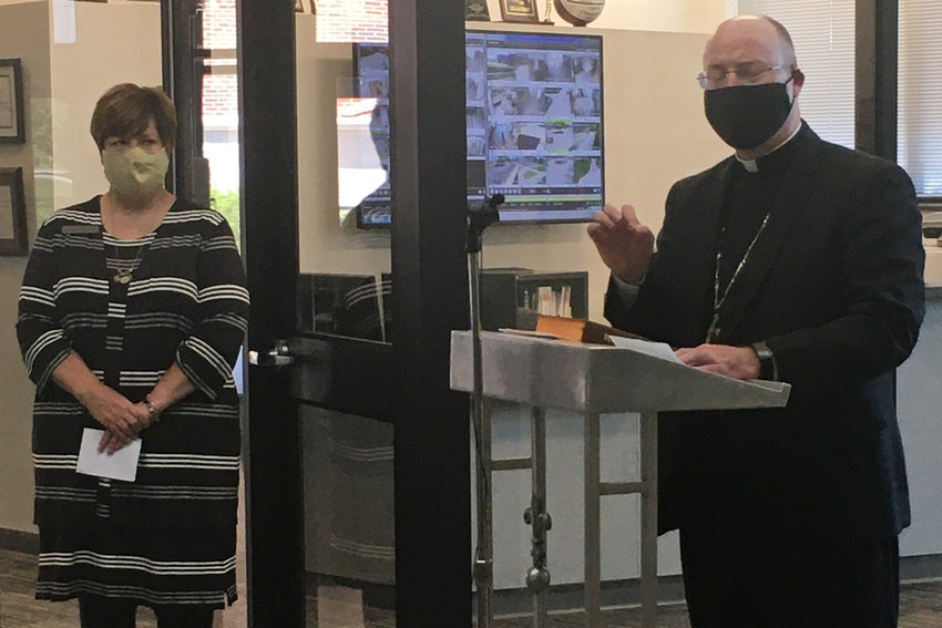 Bishop W. Shawn McKnight speaks at the dedication ceremony of the new addition to Our Lady of Lourdes Interparish School in Columbia. Dr. Erin Vader, diocesan superintendent of Catholic schools, is one of the participants.