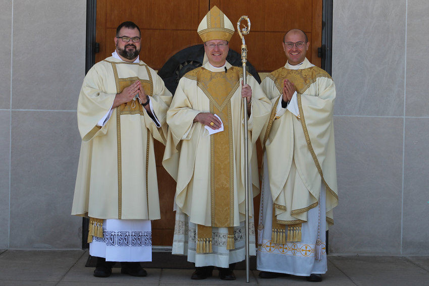 Rev. Mr. Hooper, Bishop McKnight and Rev. Mr. Hooper's brother, Father Gabriel Greer, stand outside the Cathedral of St. Joseph following Rev. Mr. Hooper's diaconal ordination.