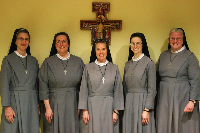 Rich Fountain native Mother M. Mediatrix Bexten FSGM (center), newly installed provincial superior of the St. Elizabeth province of the Sisters of St. Francis of the Martyr St. George, gathers with the new provincial council after their installation on March 25, the Solemnity of the Annunciation. With her are council members Sister M. Kateri Hawley, Sister M. Mikela Meidl, Sister M. Elise Mierendorf (vicaress), and Sister M. Angelica Neumann.
