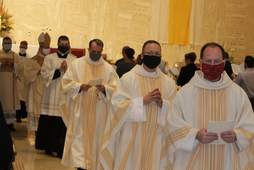 Concelebrating priests wear facemasks while processing out of the Cathedral of St. Joseph in Jefferson City at the end of Rev. Mr. Derek Hooper's diaconal Ordination Mass on May 27.