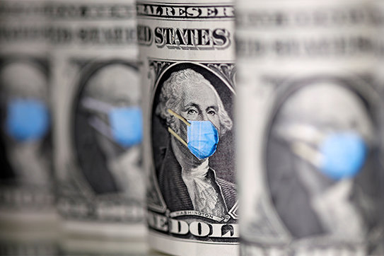 U.S. dollars are seen with facemasks during the coronavirus pandemic in this illustration photo. Dioceses are helping parishes tap revenue streams during the COVID-19 pandemic.