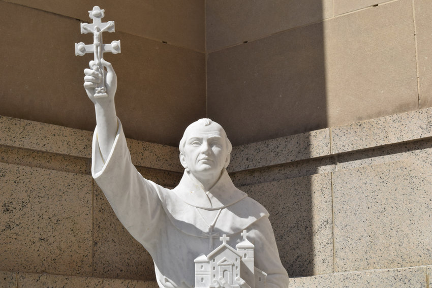 A statue of St. Junipero Serra is nestled in an alcove on the eastern side of the Basilica of the National Shrine of the Immaculate Conception in Washington July 18, 2019.