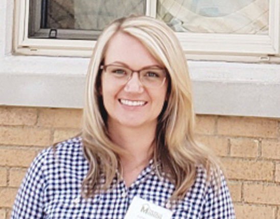Ashley Brooks pauses for a photo outside The Rolla Mission in downtown Rolla, where she serves as executive director.