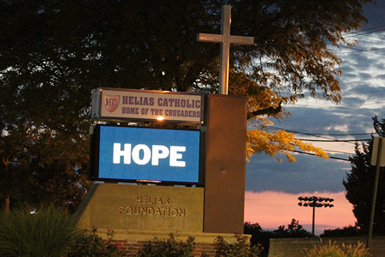 "The marquee sign outside Helias Catholic High School in Jefferson City posts a timely message during the first week of August. It refers to the verse, ""Rejoice in hope, endure in affliction, persevere in prayer."" (Romans 12:12)"