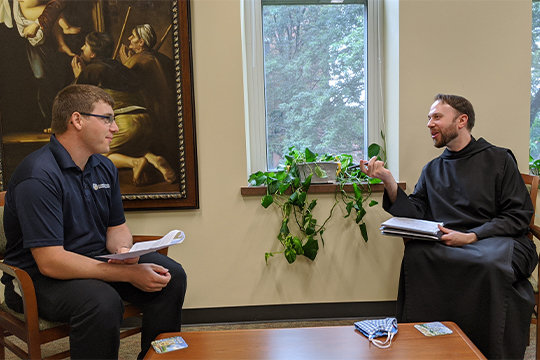 Benedictine Father Pachomius Meade, a Palmyra native and newly appointed vice rector and dean of students at Conception Seminary College in Conception, visits with a seminarian on Sept. 1 at the seminary.