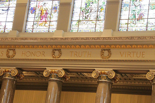 Windows, pillars and engravings adorn the  House Chamber in the Missouri State Capitol.