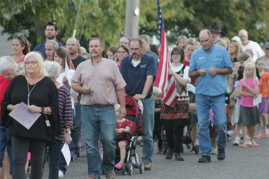 About 140 people take part in the third monthly Rosary procession to the Pike County Courthouse in Bowling Green the evening of Oct. 7, the Memorial of Our Lady of the Rosary.
