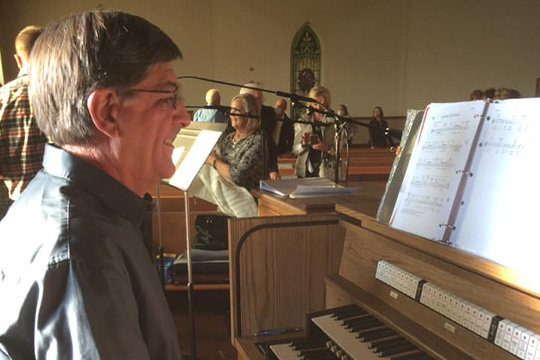 Don Yanskey prepares to draw music out of the new organ in St. Martin Church in St. Martin, where he has been serving as an accompanist for Mass for the past 50 years.