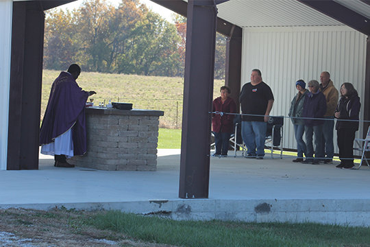 Father Augustine Okoli offers Mass at the newly-built outdoor altar on Nov. 2, All Souls Day.