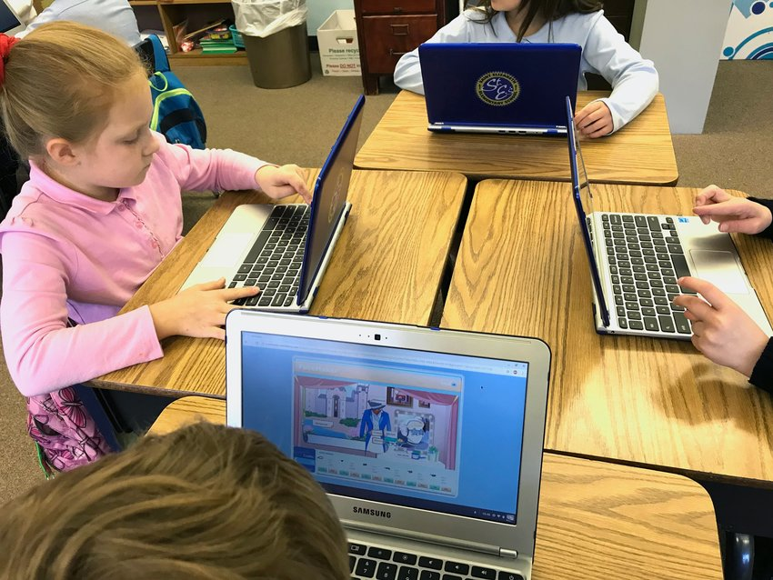 Third-grade students at St. Elizabeth School in Pleasant Hills, Pa., use Google Chromebooks March 19 to practice their math skills.