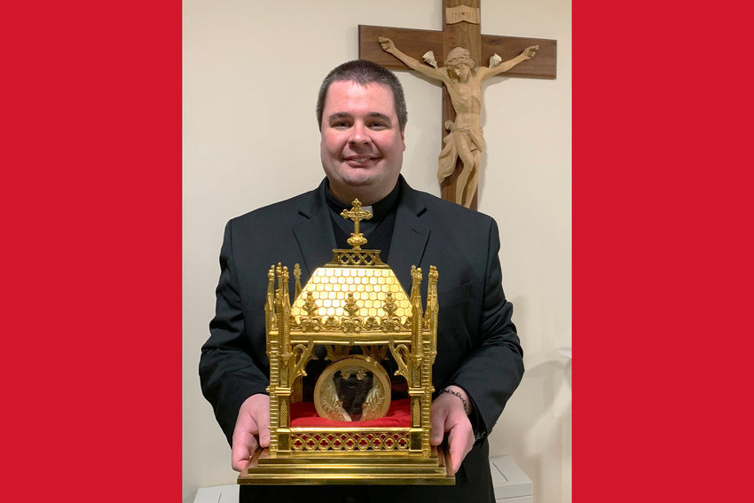Father Christopher Aubuchon holds a reliquary containing the incorrupt heart of St. John Vianney, patron saint of priests, in the Cathedral of St. Joseph during a 2019 day of prayer for vocations.