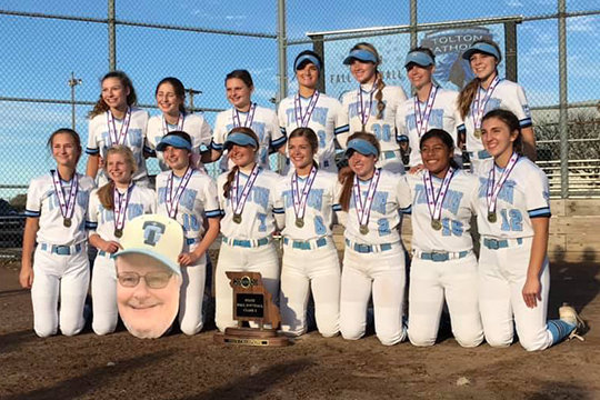 The Fr. Tolton Regional Catholic High School Trailblazers girls' softball team gathers for a team photo after winning their first state championship on Oct. 31, 2020.