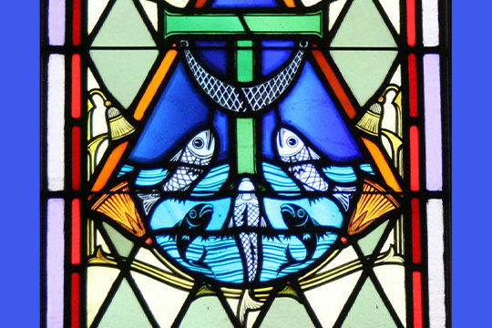 """A stained glass image representing Jesus's Apostles' role as """"fishers of men"""" adorns a window in St. Joseph Church in Martinsburg."""