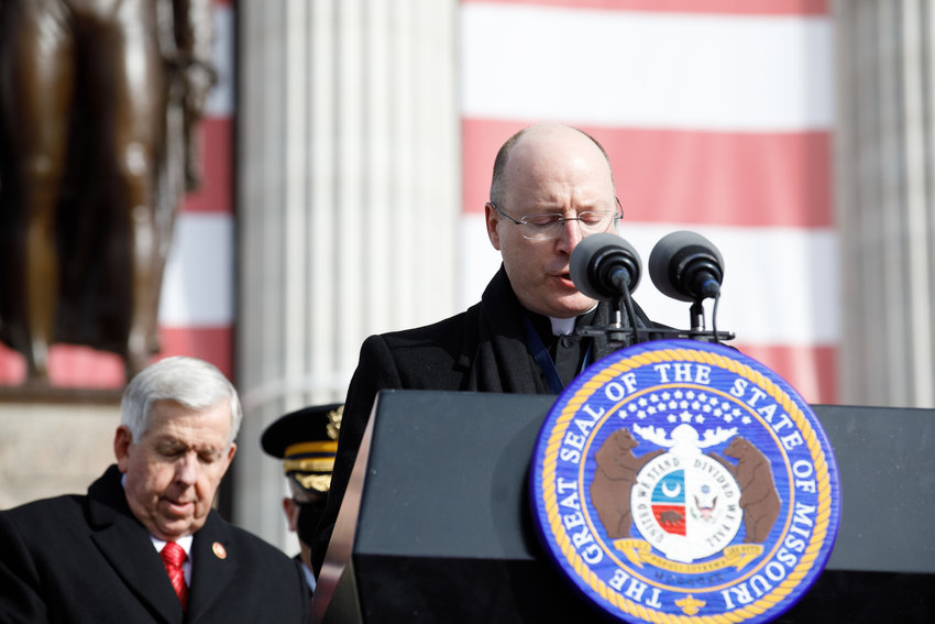 Bishop W. Shawn McKnight of Jefferson City, Missouri, gives the Benediction at the end of the inauguration ceremony for members of Missouri's executive branch outside the State Capitol in Jefferson City on Jan. 11. With him is newly sworn Gov. Michael Parson.