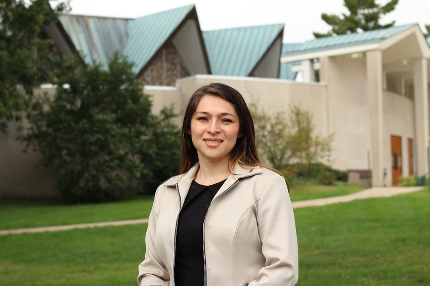 Ilsi Palacios stands outside the Cathedral of St. Joseph in Jefferson City shortly after becoming the Hispanic resource coordinator for Catholic Charities of Central and Northern Missouri.
