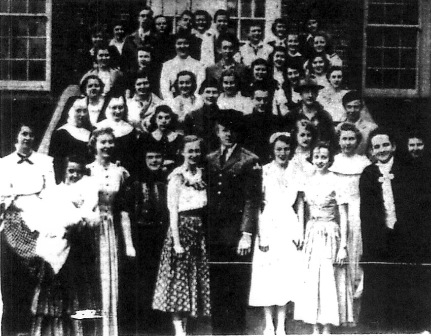 """Members of the St. Peter High School Class of 1951 gather for a group photo after the dress rehearsal for their senior production of """"The Song of Bernadette."""""""