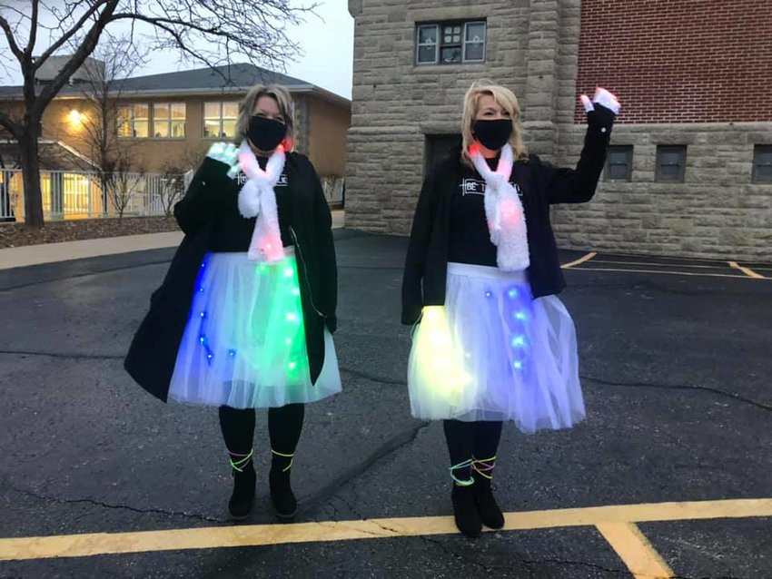 "Fourth-grade teacher Mandi Steinlage and fifth-grade teacher Connie Andrews of St. Stanislaus School in Wardsville sport their ""Be a Light"" attire on the Tuesday of Catholic Schools Week."