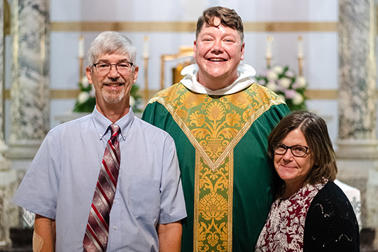 Dominican Father Joseph Paul Albin greets his parents after celebrating his Mass of Thanksgiving the day after his priestly ordination.