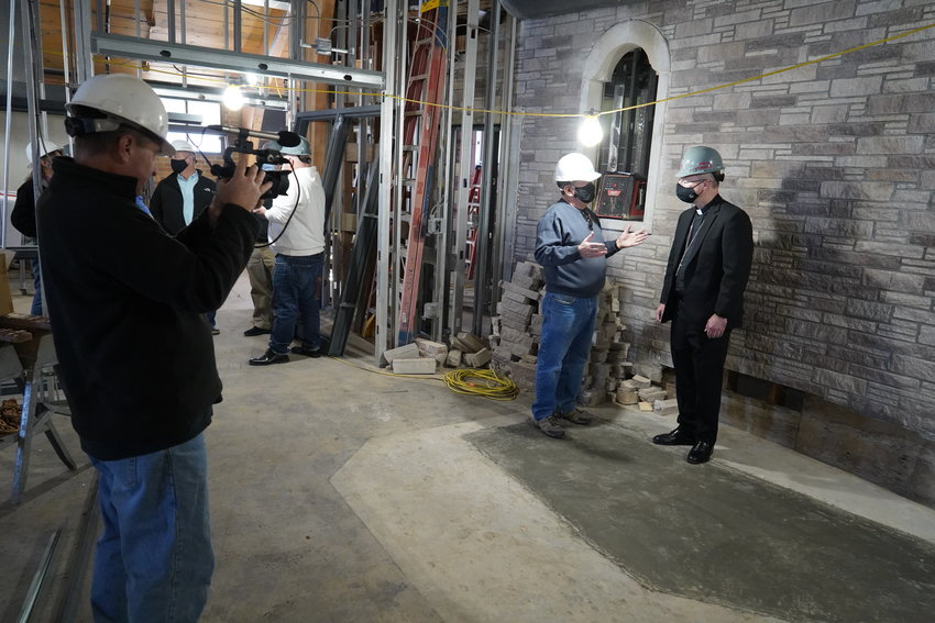 Bishop W. Shawn McKnight visits with retired local contractor Jim Wisch, a member of the CCCNMO board of directors and the Shikles redevelopment planning committee. The bishop is standing where the altar for the former La Salette Seminary Chapel once stood.