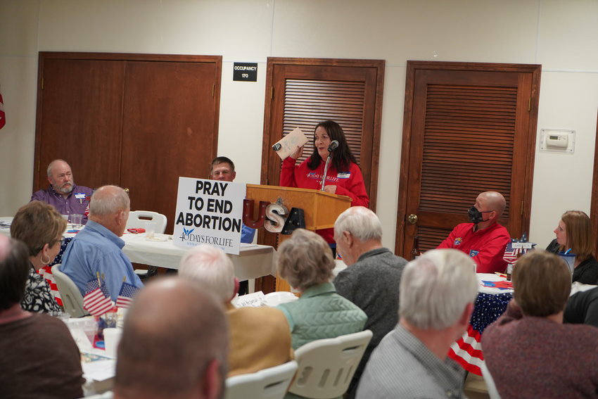 Kathy Forck, co-coordinator for the Columbia 40 Days for Life Campaign, addresses members of Knights of Columbus Dan C. Coppin Fourth Degree Assembly 573 in Jefferson City. She urged everyone to do something pro-life every day. Her husband, co-coordinator Mike Forck, is listening at the left.