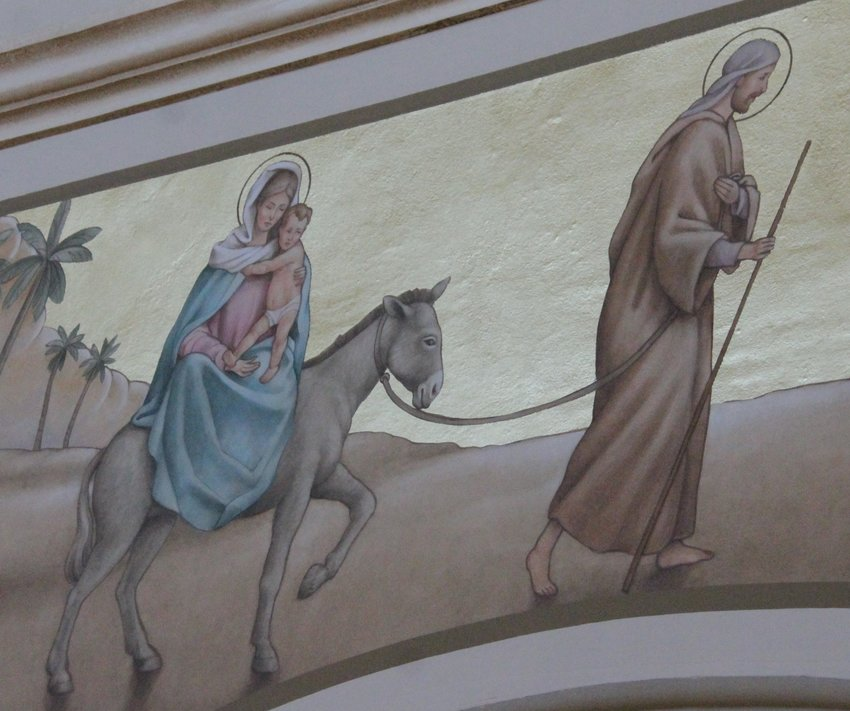 This new mural over an arch in St. Joseph Church depicts St. Joseph leading the Blessed Mother and infant Jesus into Egypt to escape the wrath of King Herod.