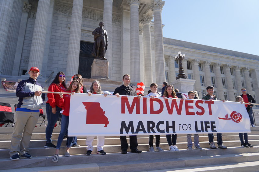 Members of St. Brendan Parish in Mexico, including their pastor, Father Dylan Schrader, carry the Midwest March for Life banner.