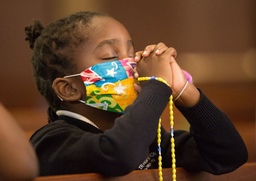 Anabel Mutune, a third grader at Transfiguration Catholic School in Oakdale, Minn., prays during a Children's Rosary Pilgrimage at Transfiguration Church in this Oct. 7, 2020, file photo. Pope Francis has called for a global prayer marathon during the Marian month of May to petition God for an end to the COVID-19 pandemic.