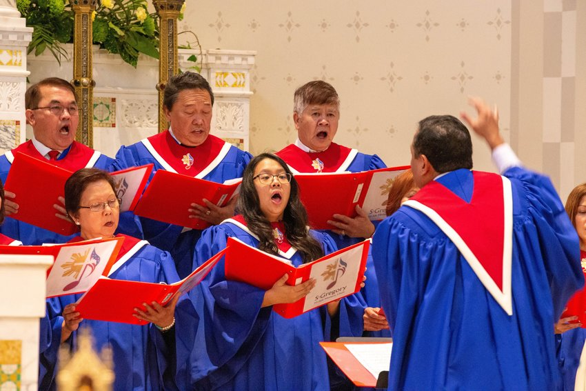 Members of the Fil-Am Choir from St. Gregory the Great Parish in Virginia Beach, Va., sing the offertory hymn during a Jan. 18, 2020, Mass. In a report released last December, the U.S. bishops' doctrine committee suggests guidelines for bishops in evaluating hymn lyrics and for selecting hymnals being considered for use in churches.